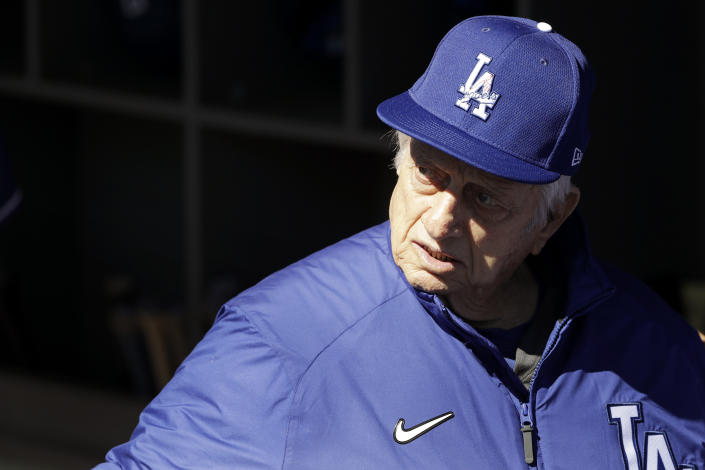 Former Los Angeles Dodgers manager Tommy Lasorda looks on from the dugout before a spring training baseball game against the Los Angeles Angels, Wednesday, Feb. 26, 2020, in Glendale, Ariz. (AP Photo/Gregory Bull)
