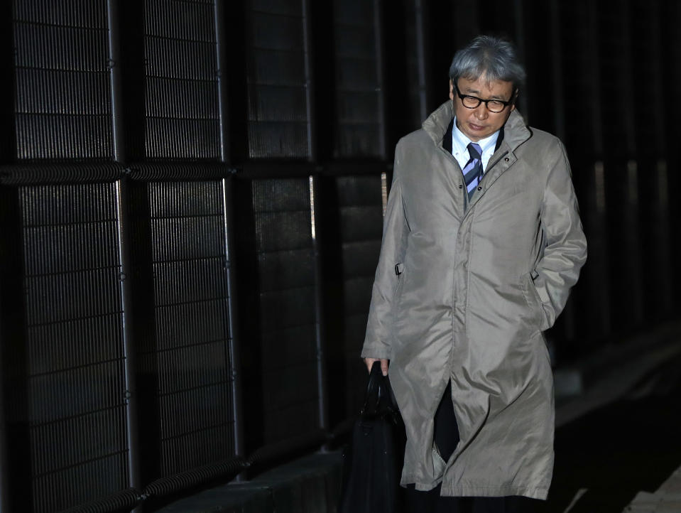 Motonari Otsuru, defense lawyer of former Nissan chairman Carlos Ghosn, leaves from Tokyo Detention Center where Ghosn and another former executive Greg Kelly are being detained in Tokyo Thursday, Dec. 20, 2018. The Tokyo District Court on Thursday rejected the request for another 10-day detention over Ghosn's indictment for falsification of financial reports. (AP Photo/Eugene Hoshiko)