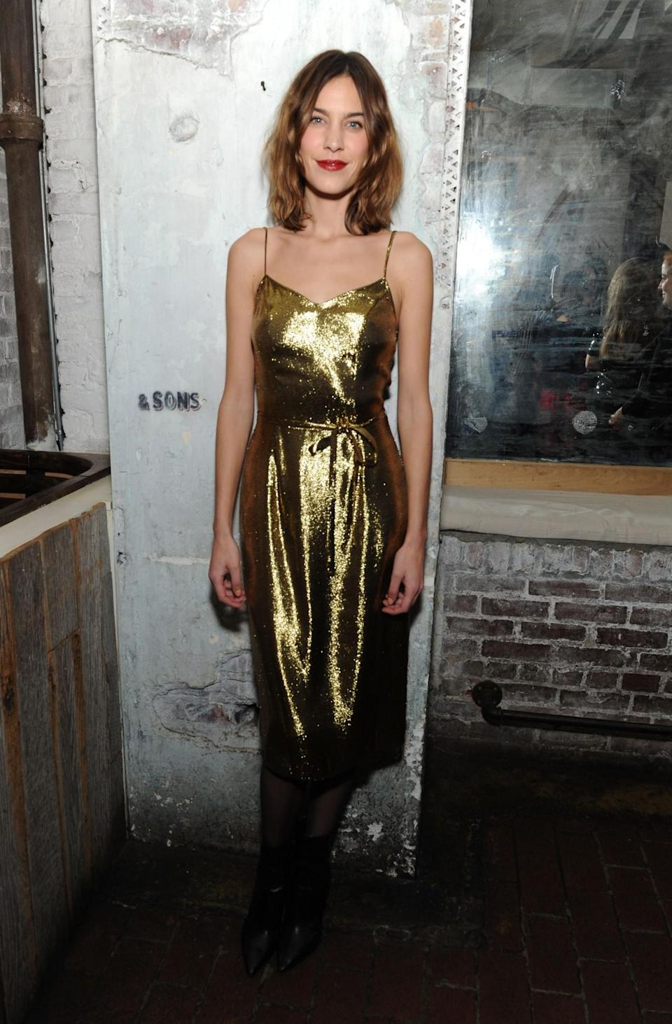 <p>Leave it to Alexa to show us how to do festive dressing with very little effort. A slinky metallic dress, some hair product and a great lippy is all it takes to be the belle of the ball. [Photo: Getty] </p>