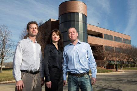 FILE PHOTO: Nick Roth (L), Jennifer Letch (C) and Craig Letch pose for a photograph at  Beef Products Inc company headquarters in Dakota Dunes, South Dakota November 19, 2012.  REUTERS/Lane Hickenbottom/File Photo