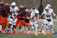 Northwestern running back Drake Anderson (6) carries the ball as Illinois defensive back Sydney Brown (30) tackles him during the first half of an NCAA college football game against Illinois Saturday, Nov. 30, 2019, in Champaign, Ill. (AP Photo/Charles Rex Arbogast)