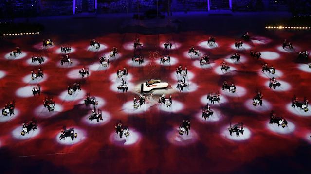 Piano players perform during the closing ceremony of the 2014 Winter Olympics, Sunday, Feb. 23, 2014, in Sochi, Russia. (AP Photo/David J. Phillip )