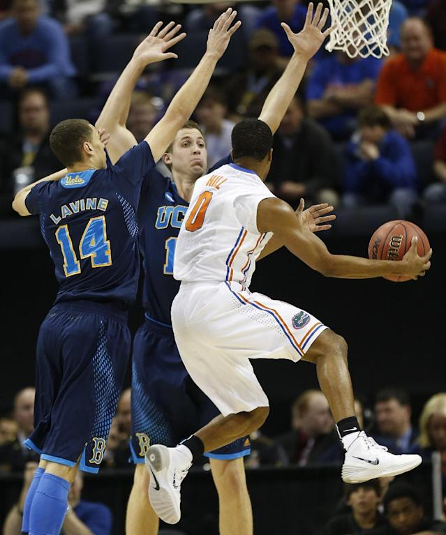 UCLA's Zach LaVine (14) and David Wear (12) defend against Florida Kasey Hill (0) during the first half in a regional semifinal game at the NCAA college basketball tournament, Thursday, March 27, 2014, in Memphis, Tenn. (AP Photo/John Bazemore)
