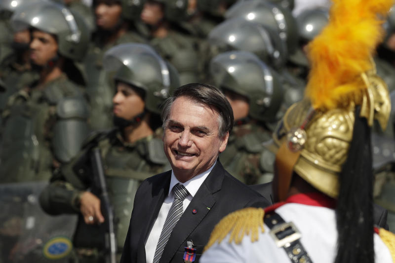 Brazils President Jair Bolsonaro arrive to attend a military ceremony for the Day of the Soldier, at Army Headquarters in Brasilia, Brazil, Friday, Aug. 23, 2019. Bolsonaro says he's leaning toward sending the army to help fight Amazon fires that have alarmed people across the globe. (AP Photo/Eraldo Peres)
