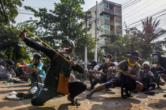 Protesters use homemade weapons such as slingshots to stop the security forces entering their neighborhood in eastern Yangon on Sunday, March 28, 2021.  (The New York Times)
