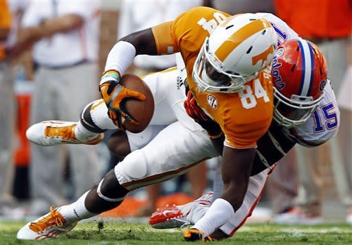 Tennessee wide receiver Cordarrelle Patterson (84) is tackled by Florida defensive back Loucheiz Purifoy (15) in the first quarter of an NCAA college football game, Saturday, Sept. 15, 2012, in Knoxville, Tenn. (AP Photo/Wade Payne)