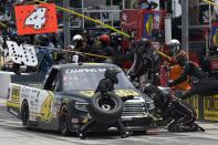 John Hunter Nemechek makes a pit stop during a NASCAR Truck Series auto race at Texas Motor Speedway in Fort Worth, Texas, Saturday, June 12, 2021. (AP Photo/Larry Papke)