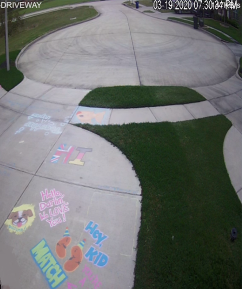 A shot of some of Shellie and Austin's creative chalk messages they left for Robert to see on their security cameras. (Photo: Shellie Callaway)