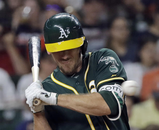 Oakland Athletics' Stephen Piscotty is hit by a pitch from Houston Astros' Lance McCullers Jr. during the fifth inning of a baseball game Wednesday, July 11, 2018, in Houston. (AP Photo/David J. Phillip)
