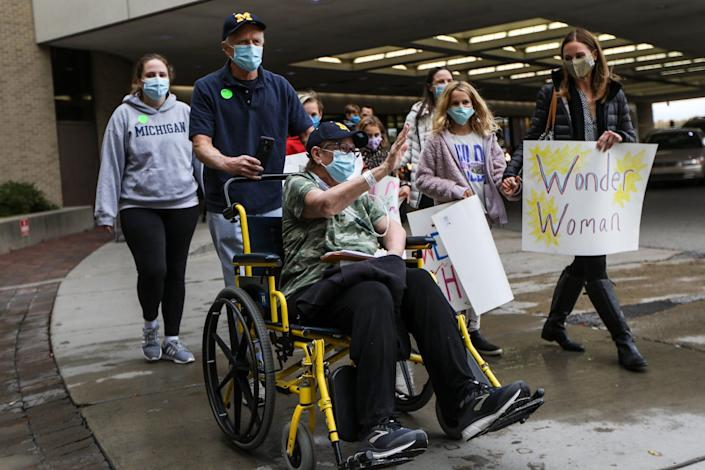 On  Oct. 15th, 2020, Deanna Hair is discharged from the University of Michigan hospital in Ann Arbor, Mich. with help from her husband, Ken Hair, who pushes her in a wheelchair after being there for 196 days battling COVID-19.