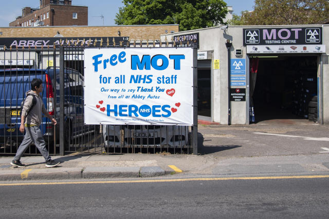 A man walks past a garage offering free MOT's for all NHS staff (Picture: Getty)