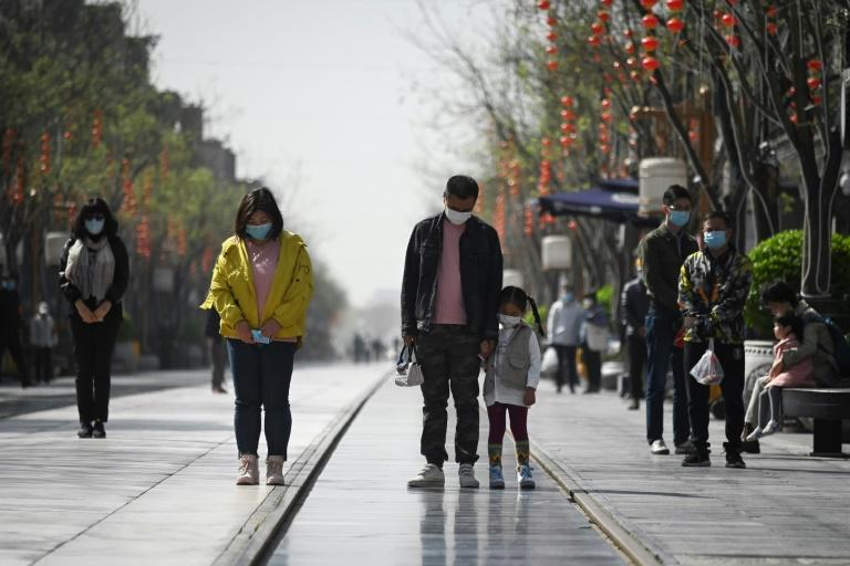 Citizens paused as cars, trains and ships sounded their horns, and air-raid sirens rang out in memory of coronavirus victims (AFP Photo/WANG ZHAO)