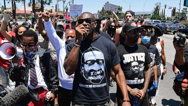 PHOTO: Former NFL wide receiver Terrell Owens leads a protest march in support of quarterback Colin Kaepernick in Inglewood, Calif., June 11, 2020. (Frederic J. Brown/AFP via Getty Images)