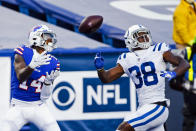 Buffalo Bills' Stefon Diggs (14) catches a pass for a touchdown in front of Indianapolis Colts' T.J. Carrie (38) during the second half of an NFL wild-card playoff football game Saturday, Jan. 9, 2021, in Orchard Park, N.Y. (AP Photo/Jeffrey T. Barnes)