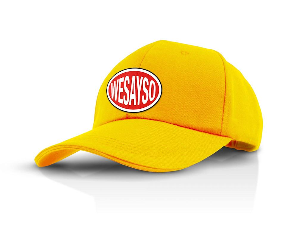 A yellow WESAYSO Development Corporation hat