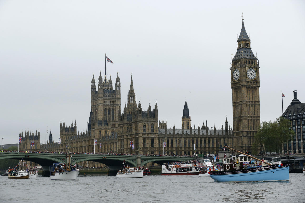 LONDON, ENGLAND - JUNE 03:  Boats pass by the Houses of Parliament and Big Ben during the Diamond Jubilee Thames River Pageant on June 3, 2012 in London, England. For only the second time in its history the UK celebrates the Diamond Jubilee of a monarch. Her Majesty Queen Elizabeth II celebrates the 60th anniversary of her ascension to the throne. Thousands of well-wishers from around the world have flocked to London to witness the spectacle of the weekend's celebrations. The Queen along with all members of the royal family will participate in a River Pageant with a flotilla of a 1,000 boats accompanying them down The Thames, the star studded free concert at Buckingham Palace, and a carriage procession and a service of thanksgiving at St Paul's Cathedral.  (Photo by Matt Dunham - WPA Pool/Getty Images)
