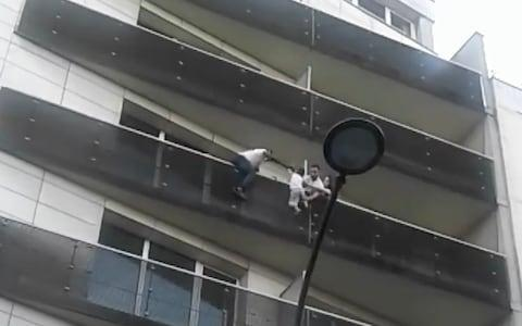 <span>Mamoudou Gassam rescues young child from building in Paris </span> <span>Credit: Telegraph </span>