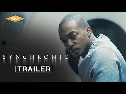 """<p>Aaron Moorhead and Justin Benson are genre filmmakers adept at crafting time-travel stories that double as subtle inquiries into the human condition, and their latest, <em>Synchronic</em>, is their most straightforward and high-profile venture to date. For New Orleans paramedics Dennis (Jamie Dornan) and Steve (Anthony Mackie), life has turned out to be an unexpected disappointment, and their discontent with their disparate stations in life (Dennis is an unhappy husband and father; Steve is a lonely and aimless ladies man) is amplified by a spate of deaths that seem to be related to a new synthetic drug called synchronic that causes Dennis' 18-year-old daughter to disappear. As Steve soon learns, synchronic has the capacity to spirit users to bygone eras, which instigates a quest that speaks directly to larger issues of mortality, loss, grief, and the push-pull between dreams and reality. Everything is connected in this economical and thrilling sci-fi saga, as the writer/directors – aided by understated performances from their Hollywood leads – deliver a unique vision of intertwined fates, the links between the past and the future, and the importance of cherishing the present moment.</p><p><a href=""""https://www.youtube.com/watch?v=fl_kzTQvPVw"""" rel=""""nofollow noopener"""" target=""""_blank"""" data-ylk=""""slk:See the original post on Youtube"""" class=""""link rapid-noclick-resp"""">See the original post on Youtube</a></p>"""