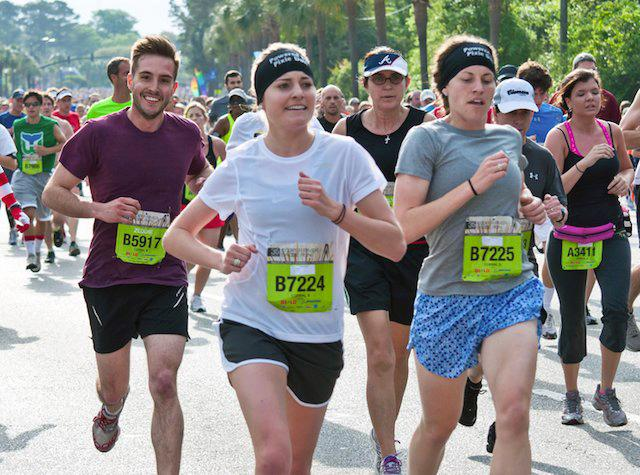 "This snap of 25-year-old Zeddie Little running a 10K race in Charleston, S.C., shows a smiling competitor looking so coiffed he stands out from the rest of the struggling runners. Photographer Will King posted the pic on his Flickr account and then on the website Reddit — and ""ridiculously photogenic guy"" quickly became a meme. (Will King/Flickr)"