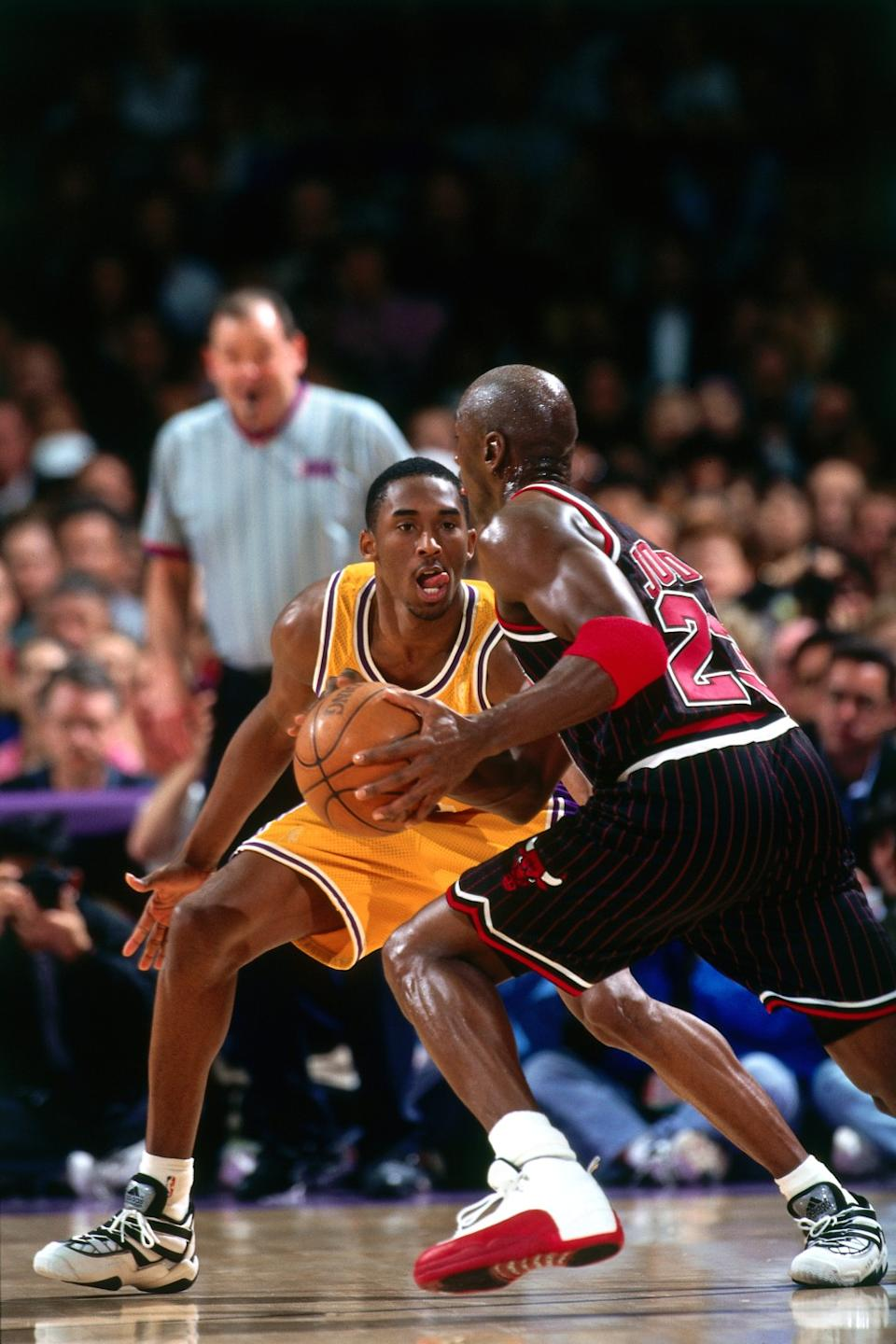 Chicago Bulls forward drives against Lakers guard Kobe Bryant during a game at the Forum in February 1997.