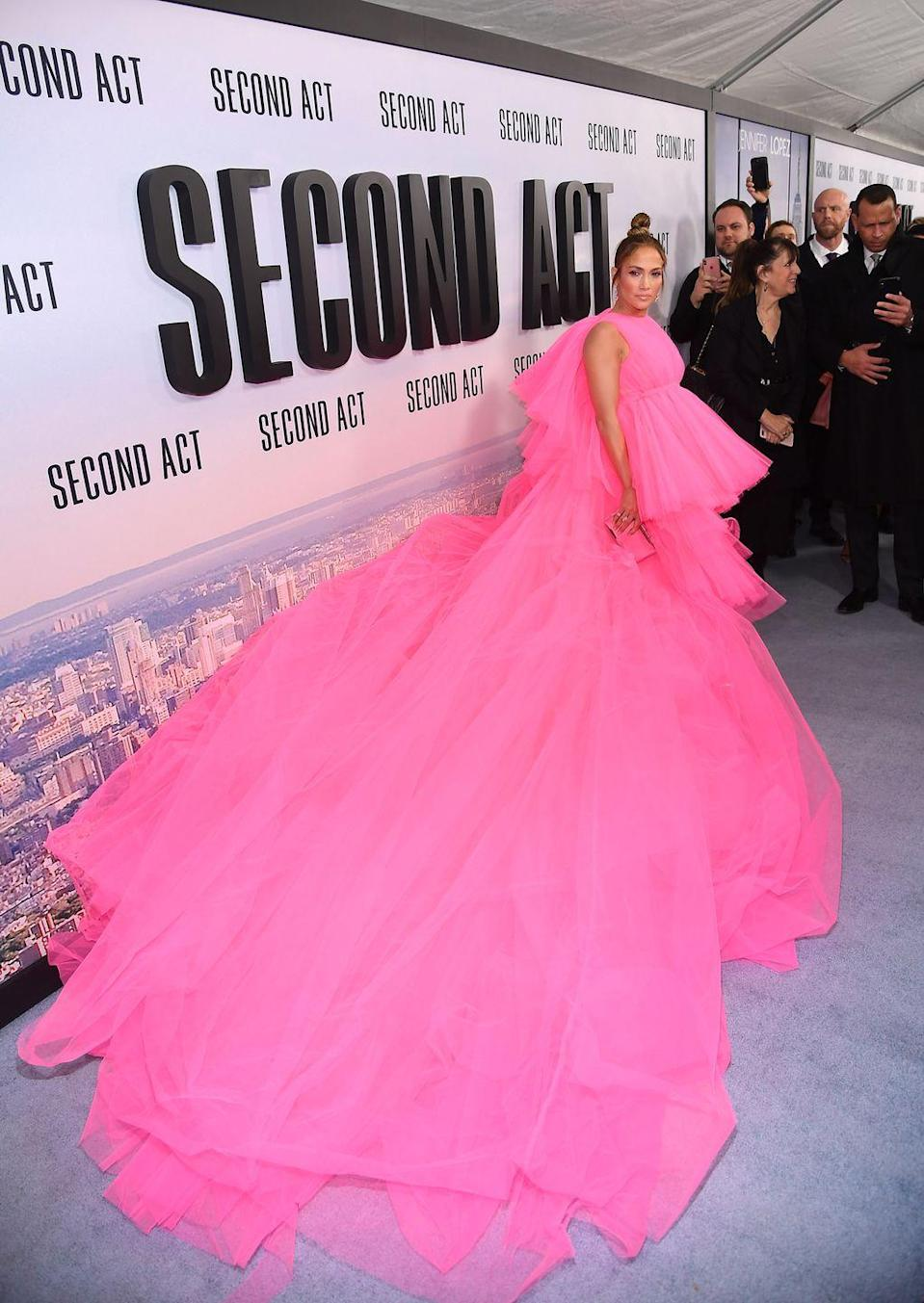 <p>In an enormous Giambattista Valli pink couture tulle gown for the premiere.</p>