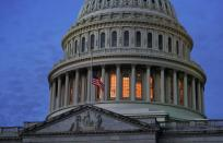 Dawn breaks on the U.S. Capitol after the House voted to impeach U.S. President Donald Trump in Washington