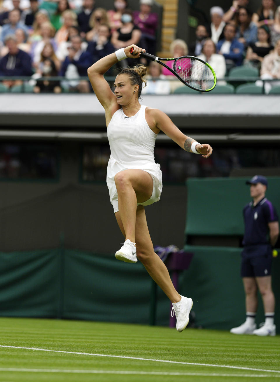 Belarus's Aryna Sabalenka returns a ball to Romania's Monica Niculescu during their first round women's singles match on day one of the Wimbledon Tennis Championships in London, Monday June 28, 2021. (AP Photo/Alastair Grant)