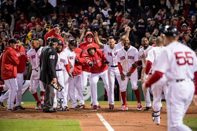 Sandy Leon gets the traditional walk-off welcome. (Photo by Billie Weiss/Boston Red Sox/Getty Images)