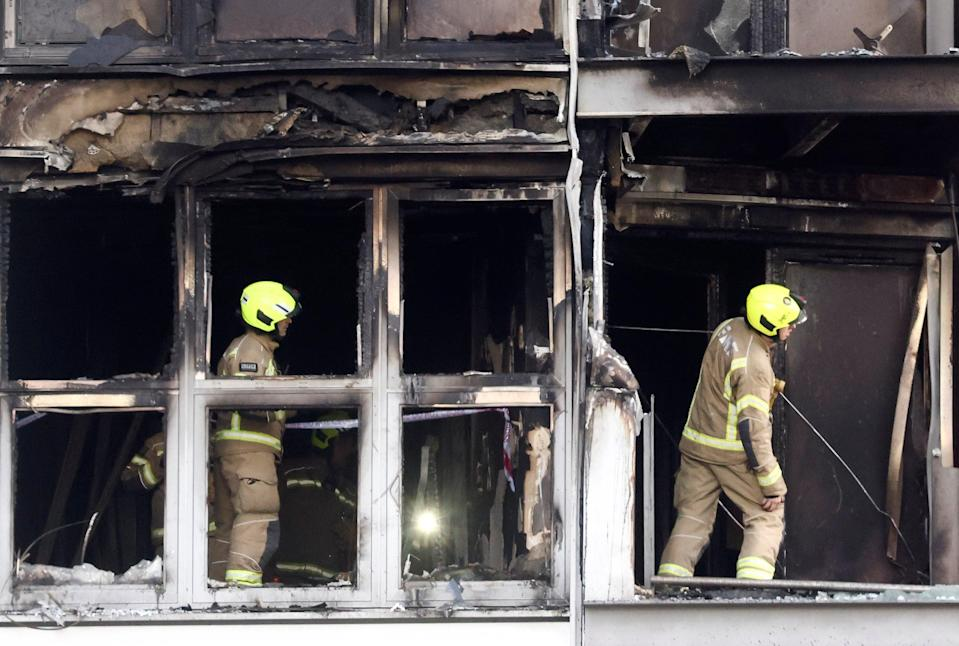 Firefighters work at a damaged residential building in East LondonREUTERS