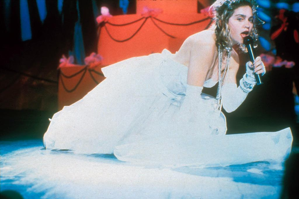 "During the very first MTV VMAs back in 1984, the original Material Girl paved the way for future fashion disasters when she wore a sheer skirt, white bustier, and a belt that said ""boy toy,"" along with her many signature early-'80s accessories, while singing ""Like a Virgin."" Frank Micelotta/<a href=""http://www.gettyimages.com/"" target=""new"">GettyImages.com</a> - September 14, 1984"