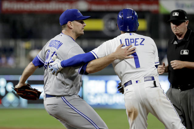 Toronto Blue Jays relief pitcher Daniel Hudson catches Kansas City Royals' Nicky Lopez (1) after tagging him out at first to end a baseball game Tuesday, July 30, 2019, in Kansas City, Mo. Toronto won 9-2. (AP Photo/Charlie Riedel)