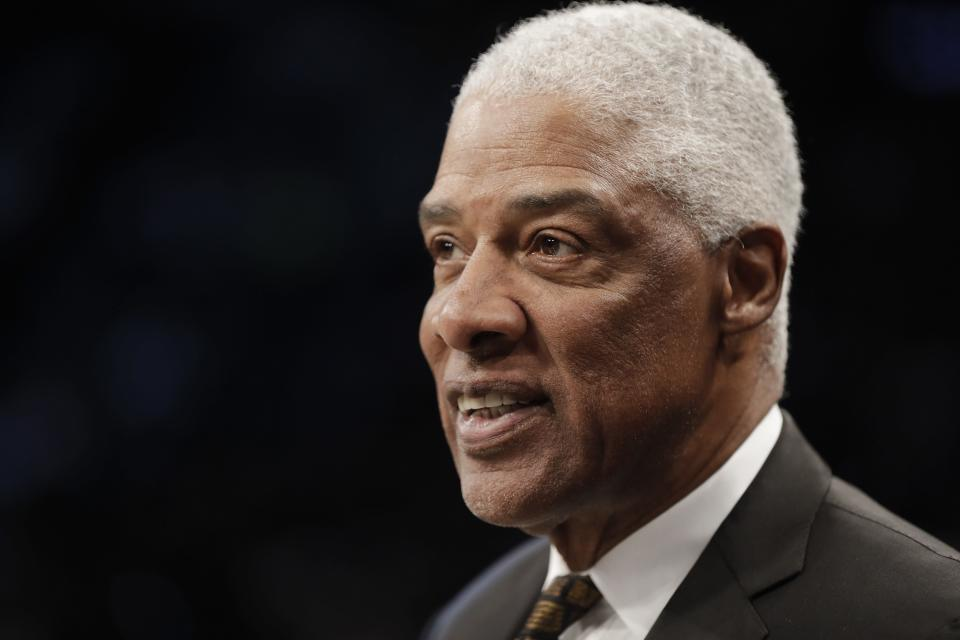 Julius Erving watches players warm up before an NBA basketball game between the Brooklyn Nets and the San Antonio Spurs Friday, March 6, 2020, in New York. (AP Photo/Frank Franklin II)