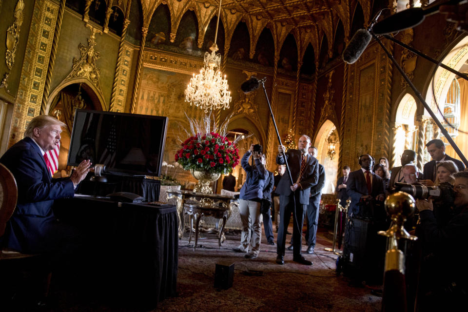 President Donald Trump speaks to members of the media following a Christmas Eve video teleconference with members of the military at his Mar-a-Lago estate in Palm Beach, Fla., Tuesday, Dec. 24, 2019. (AP Photo/Andrew Harnik)