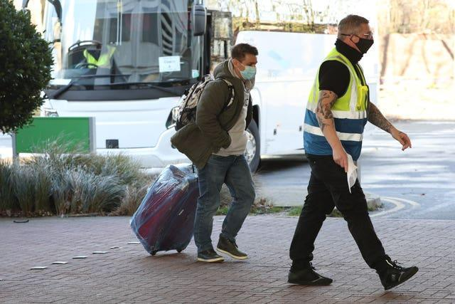A passenger is escorted to the Holiday Inn hotel near Heathrow Airport