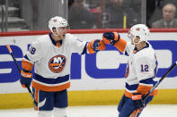 New York Islanders left wing Anthony Beauvillier (18) celebrates his second goal of the game with right wing Josh Bailey (12) during the first period of an NHL hockey game against the Washington Capitals, Monday, Feb. 10, 2020, in Washington. (AP Photo/Nick Wass)