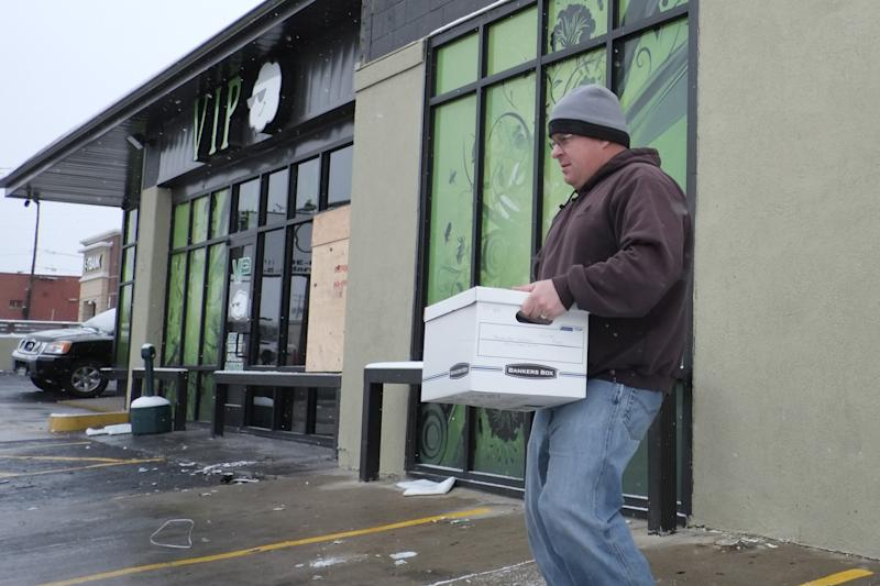 A federal agent carries a box from VIP Cannabis dispensary in Denver on Thursday, Nov. 21, 2013 during a raid on the business. Federal agents raided an unknown number of marijuana dispensaries and growing sites in Colorado, confiscating piles of marijuana plants and cartons of cannabis-infused drinks just weeks before the state allows recreational marijuana retailers to open their doors. (AP Photo/Ed Andrieski)