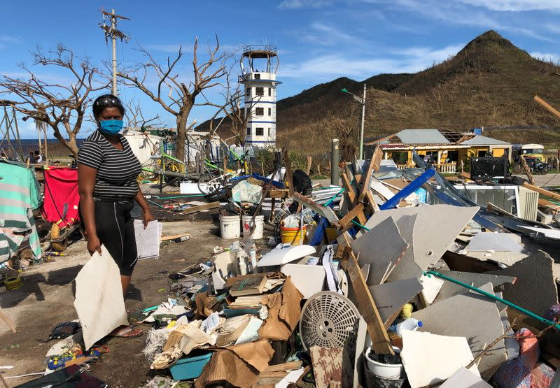 Naeeth Novaglia, 32, collects some debris from her home that was destroyed by the passage of Storm Iota