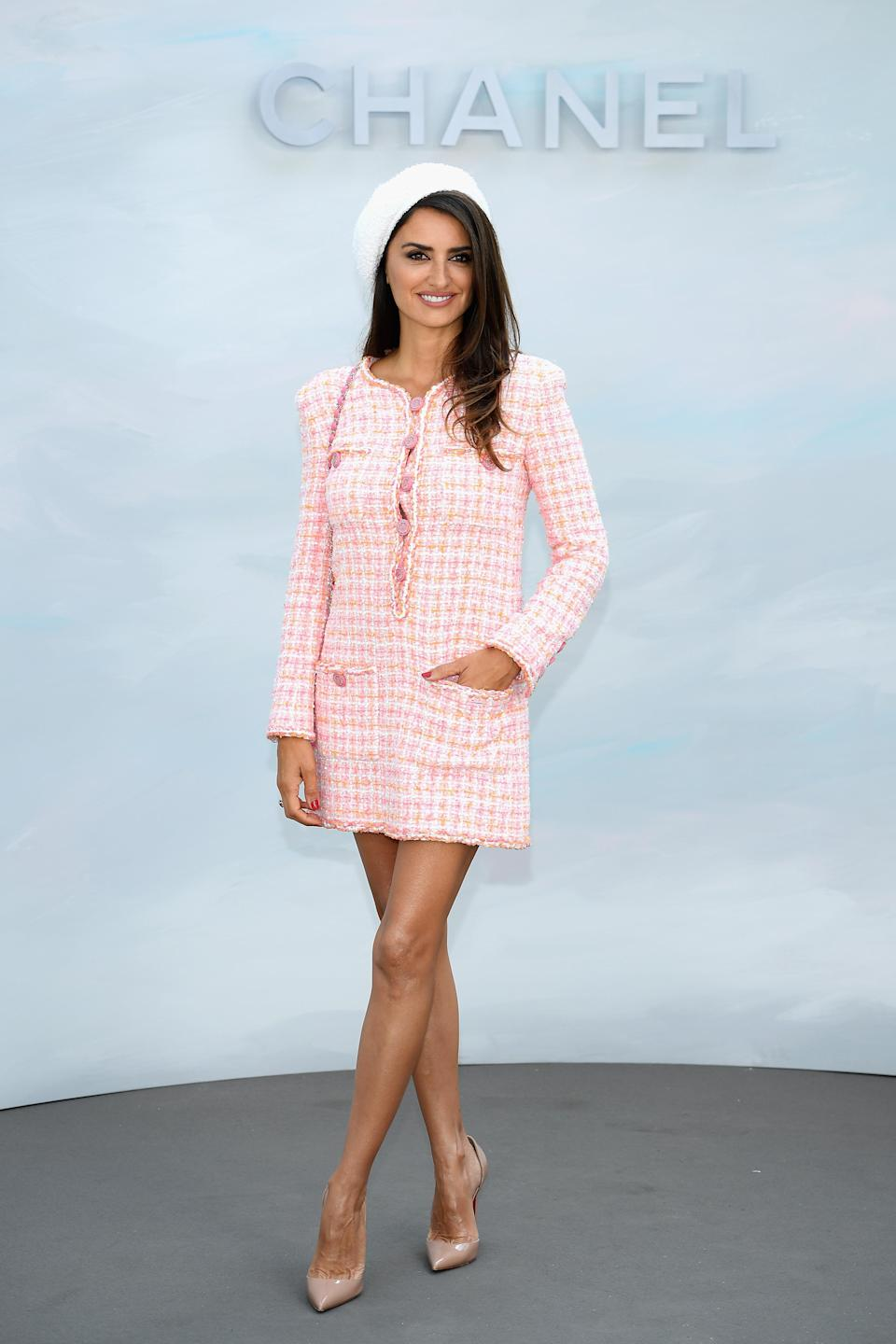 <p>Penelope Cruz demonstrated how to nail Parisian chic at Chanel's haute couture show on 3 July in a tweed dress by Chanel topped with a beret. <em>[Photo: Getty] </em> </p>