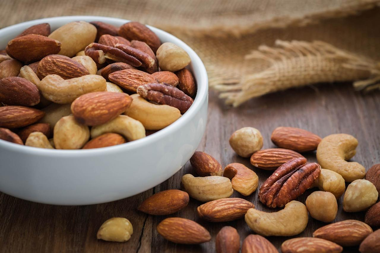 """<p>Nuts like peanuts, cashews, and walnuts don't just add a tasty crunch to your cereal—they're also packed with protein. """"It's so easy to have a protein-less choice for breakfast, and around 10 you think, 'That breakfast didn't stick with me,'"""" says Libby Mills, MS, RDN, LDN, FAND, spokeswoman for the Academy of Nutrition and Dietetics. She recommends getting a minimum of seven grams of protein in the morning. One ounce of nuts has about five or six grams to start you off on the right foot. Pick a raw variety, which keeps the <a rel=""""nofollow"""" href=""""http://www.rd.com/health/diet-weight-loss/healthy-fats/1/"""">healthy oils</a> intact. Learn more about how <a rel=""""nofollow"""" href=""""http://www.rd.com/health/wellness/best-disease-fighter-nuts/"""">nuts can help fight disease</a>.</p>"""