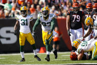 Green Bay Packers defensive tackle T.J. Slaton (93) celebrates a sack against the Cincinnati Bengals in the first half of an NFL football game in Cincinnati, Sunday, Oct. 10, 2021. (AP Photo/Bryan Woolston)