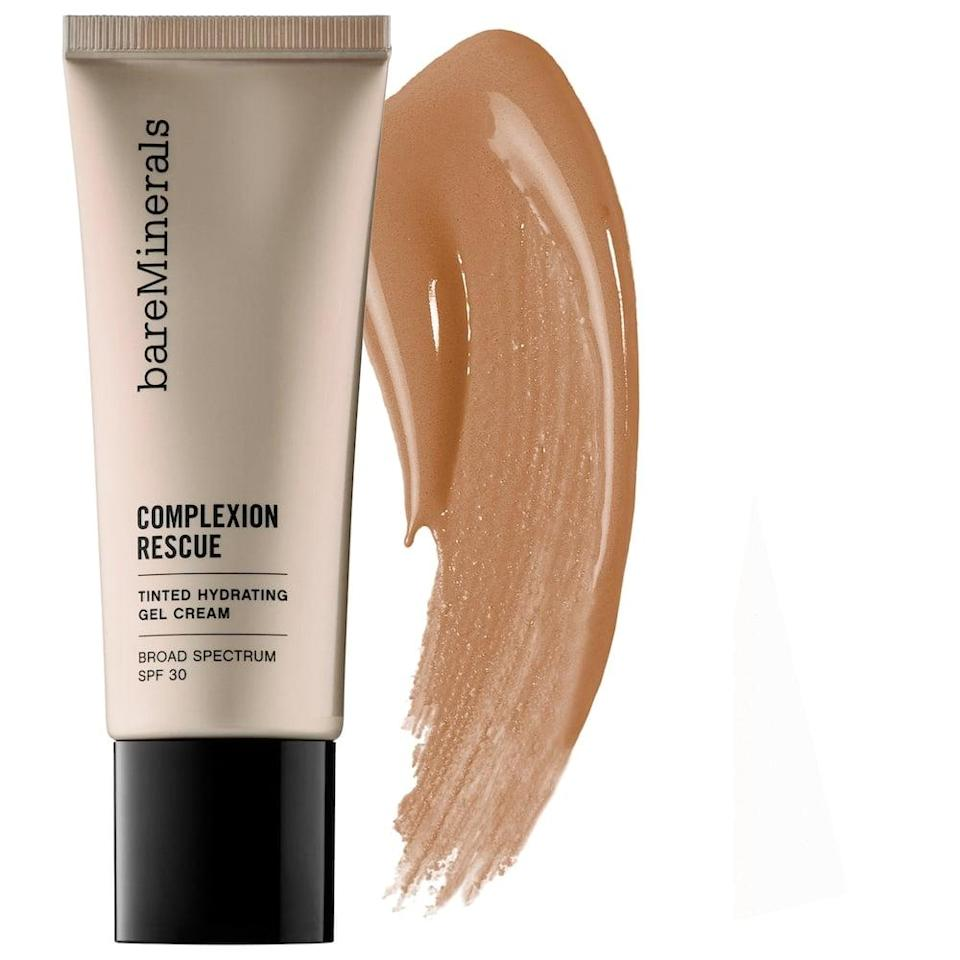"""<p>The <span>bareMinerals Complexion Rescue Tinted Moisturizer with Hyaluronic Acid and Mineral SPF 30 </span> ($33) is hydrating with a cream, dewy finish. It has a light-to-medium buildable coverage. You can read an <a href=""""https://www.popsugar.com/beauty/bareminerals-complexion-rescue-tinted-moisturizer-review-48078528"""" class=""""link rapid-noclick-resp"""" rel=""""nofollow noopener"""" target=""""_blank"""" data-ylk=""""slk:in-depth review here."""">in-depth review here.</a></p>"""