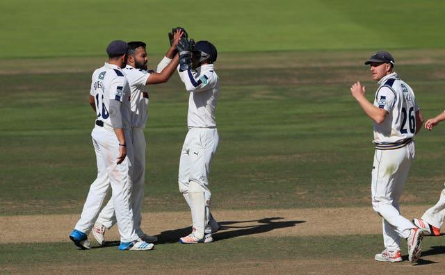 Azeem Rafiq, second left, celebrates taking the wicket of Middlesex's Nick Gubbins during his playing days with the club