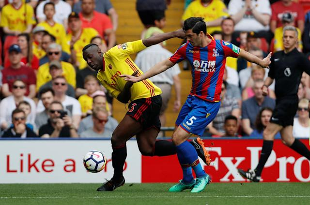 """Soccer Football - Premier League - Watford v Crystal Palace - Vicarage Road, Watford, Britain - April 21, 2018 Watford's Stefano Okaka in action with Crystal Palace's James Tomkins Action Images via Reuters/Paul Childs EDITORIAL USE ONLY. No use with unauthorized audio, video, data, fixture lists, club/league logos or """"live"""" services. Online in-match use limited to 75 images, no video emulation. No use in betting, games or single club/league/player publications. Please contact your account representative for further details."""
