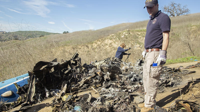 Investigators, pictured here working at the scene of the helicopter crash that killed Kobe and Gianna Bryant.