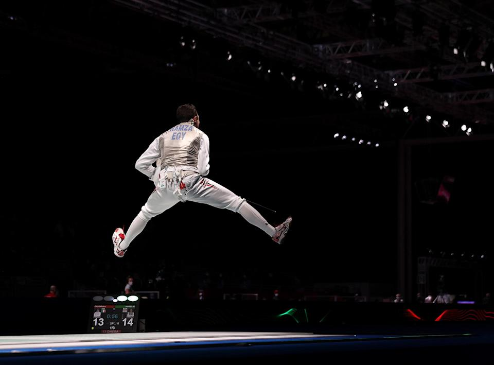 <p>Mohamed Hamza of Egypt celebrates after defeating Andrea Cassara of Italy in men's foil individual fencing on July 26.</p>