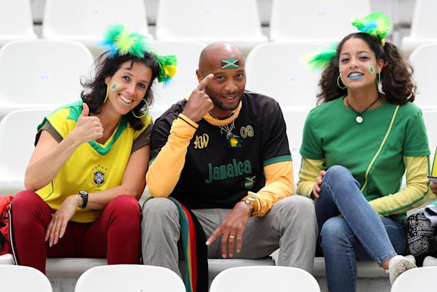 Fans of Jamaica pose for a photograph prior to the 2019 FIFA Women's World Cup France group C match between Brazil and Jamaica at Stade des Alpes on June 09, 2019 in Grenoble, France. (Photo by Elsa/Getty Images)