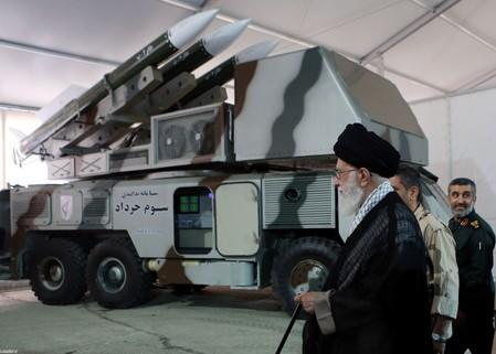 """Iran's Supreme Leader Ayatollah Ali Khamenei is seen near a """"3 Khordad"""" system which is said to had been used to shoot down a U.S. military drone"""