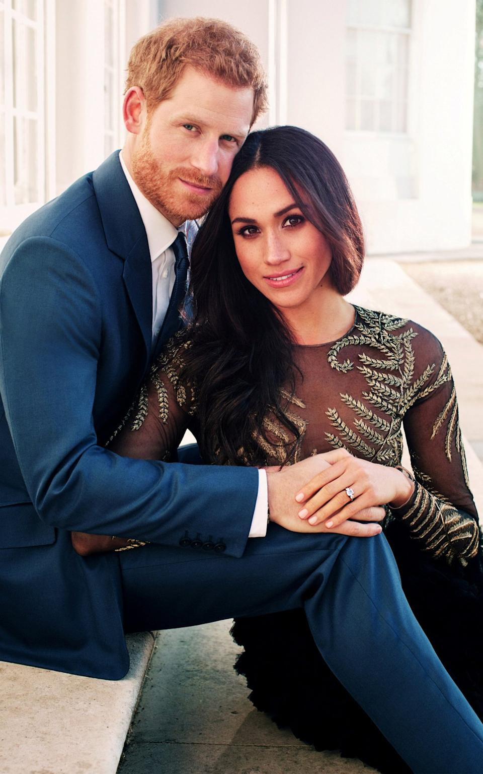 Meghan wearing Ralph and Russo's £56,000 gown in the engagement portraits - Reuters