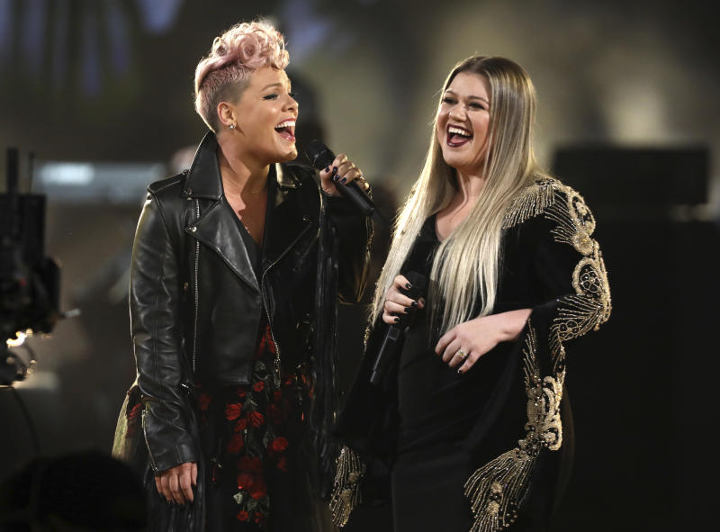 """Pink, left, and Kelly Clarkson perform """"Everybody Hurts"""" at the American Music Awards at the Microsoft Theater on Sunday, Nov. 19, 2017, in Los Angeles. (Photo by Matt Sayles/Invision/AP)"""