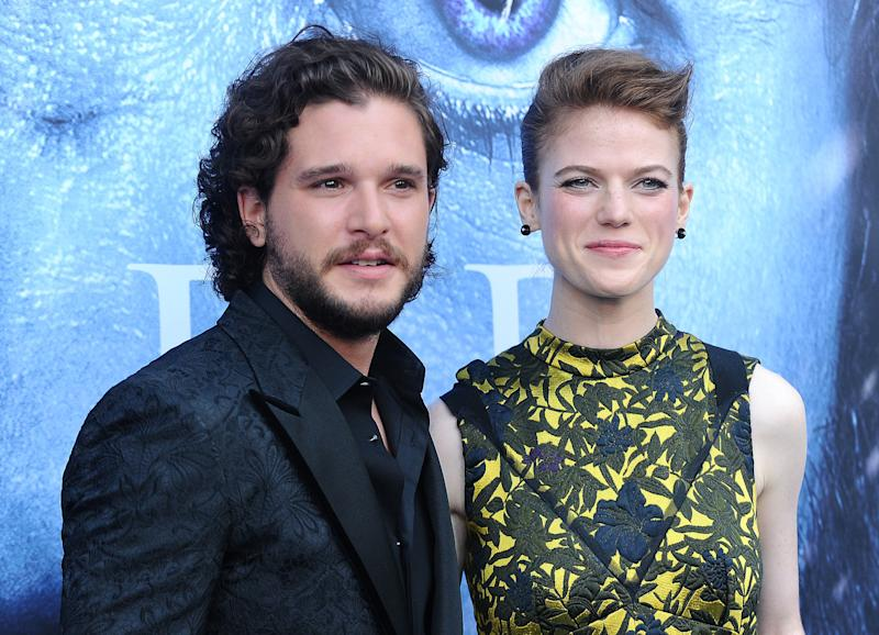 """Kit Harington, left, said it was """"really embarrassing"""" to wear his """"Game of Thrones"""" character Jon Snow's costume to a party, after being forced into it by his future wife Rose Leslie, right. (Jason LaVeris via Getty Images)"""